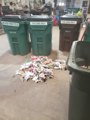 Trash sorted from recycling receptacles.