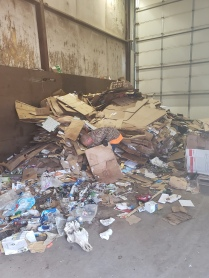 Trash put in with cardboard recycling